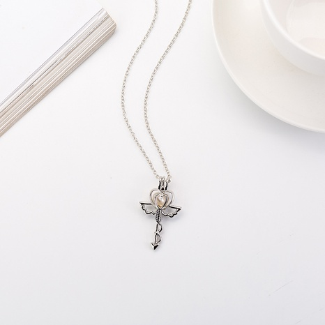 European and American DIY pearl cage clavicle chain hollow metal love angel necklace wholesale NHDB445477's discount tags