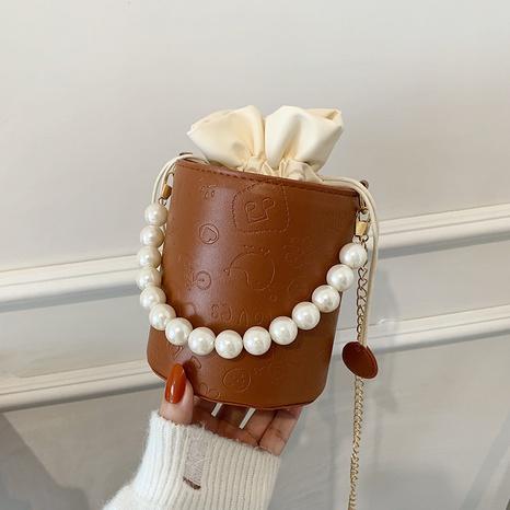 trendy texture small bag bucket round barrel pearl chain messenger bag  NHRU438650's discount tags