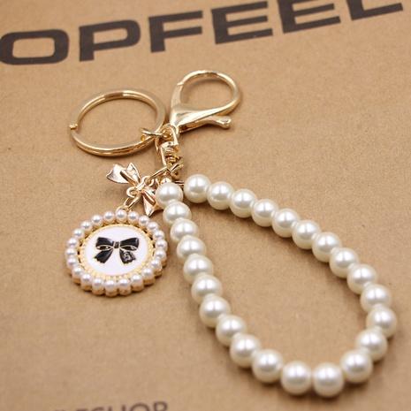 Bowknot Pearl Bracelet Bag Keychain Lady Cute High-end Purse Dripping Bowknot Tag Pendant NHZUG439182's discount tags