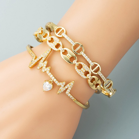 Korean fashion net celebrity ECG pattern bracelet copper plated 18K gold inlaid zircon exaggerated bracelet NHYIS440120's discount tags