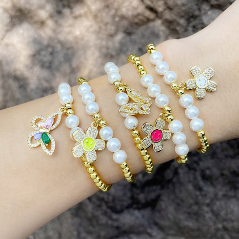 European and American simple butterfly elastic bracelet female sun flower smiley face bracelet  NHAS440346's discount tags