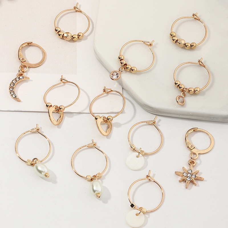 Fashion Creative Small Stars Pearl Shell Earrings Set NHNZ316301