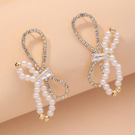 Retro-Ohrringe mit Diamantbesatz und Perlenschleife NHNJ316537's discount tags