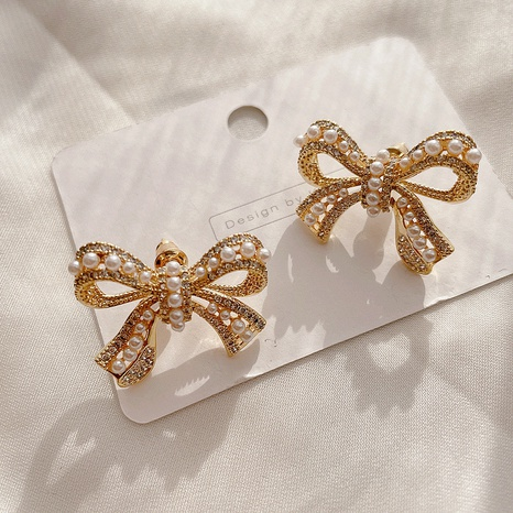 micro-inlaid pearl bow earrings NHHI316737's discount tags