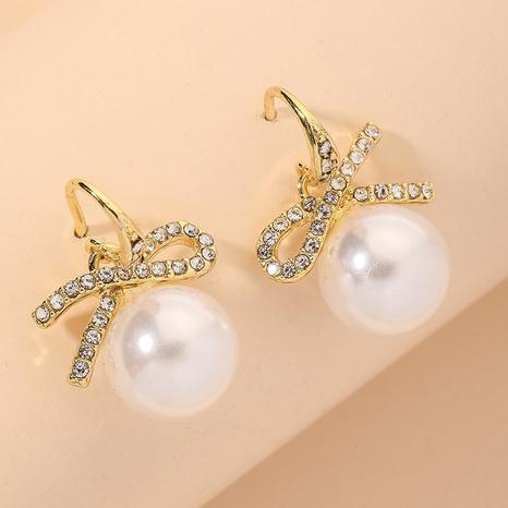 diamond bowknot pearl fashion earrings NHNJ317405's discount tags