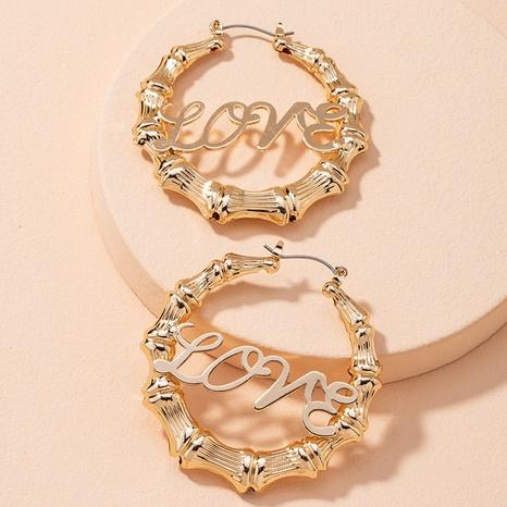 grandes boucles d'oreilles dorées en bambou NHAI314292's discount tags