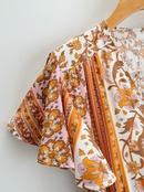 vestido estampado con cuello de pico y manga corta NHAM314373