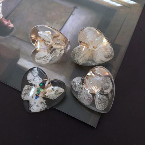 Boucles d'oreilles feuille de fleur en résine transparente NHOM314566's discount tags