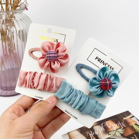 Conjunto de clip BB de botón a cuadros de color puro de moda NHCU318522's discount tags