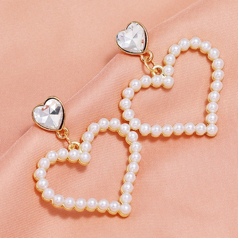 Korean Fashion Sweet Love Pearl Stud Earrings NHSC322116's discount tags