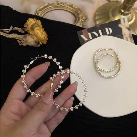 Korea fashion pearl circle earrings NHQC322111's discount tags
