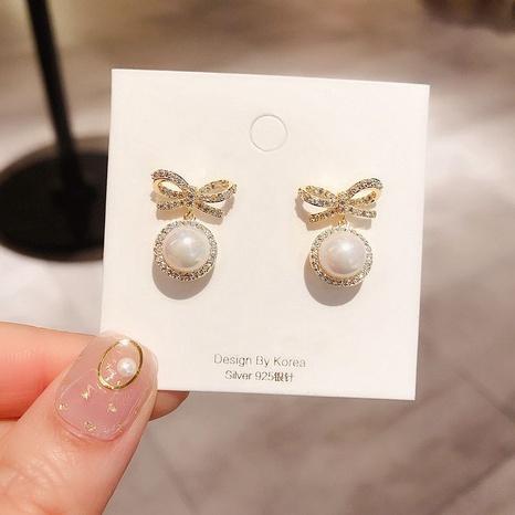Korean Fashion Bow Pearl Earrings Wholesale NHXI322207's discount tags
