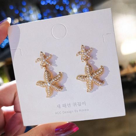 Boucles d'oreilles étoiles simples coréennes en gros NHXI322217's discount tags