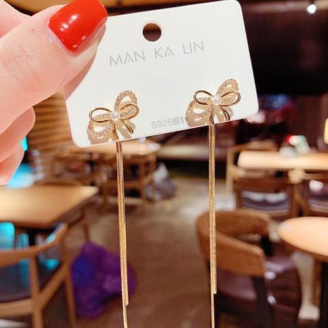 Boucles d'oreilles coréennes avec perles à nœud papillon NHXI322226's discount tags