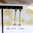 NHOM1489131-Round-Pearl-Pendant-Silver-Pin-Stud-Earrings