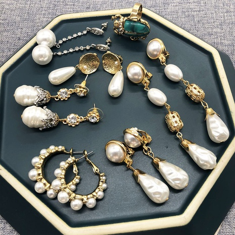 fashion white pearl retro water drop earrings NHOM322416's discount tags