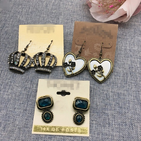 palace style retro crown heart earrings  NHOM322418's discount tags