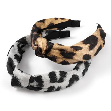Korean leopard cloth fabric headband NHJE323551's discount tags
