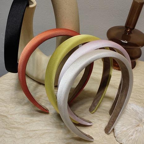 Korean simple candy color sponge fabric headband NHAR323849's discount tags