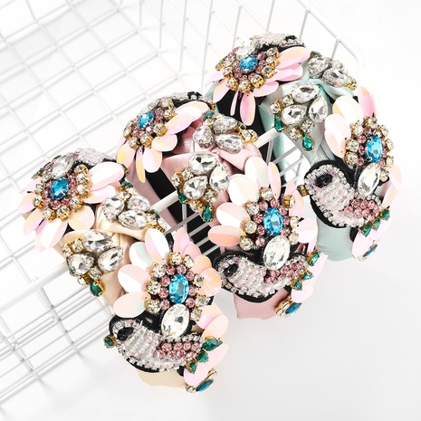 nueva banda de pelo de lentejuelas de plástico de flor de pájaro de franela de moda NHJE323993's discount tags