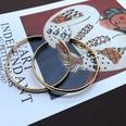 NHOM1494861-Golden-large-metal-ring-earrings-6.5-cm