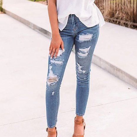 Spring women's high-waisted elastic hole solid color jeans for women NHWA324644's discount tags