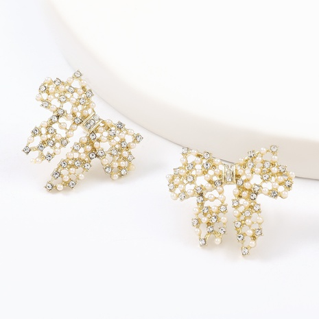 Korean simple alloy diamond inlaid pearl bow earrings NHJE324960's discount tags