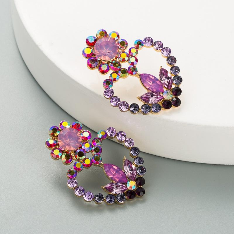 hollow heartshaped flower alloy diamond earrings NHLN324981