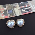 NHOM1469530-Heart-shaped-pearl-and-silver-pin-stud-earrings