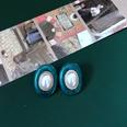 NHOM1469473-Oval-pearl-green-ear-clip-22.8
