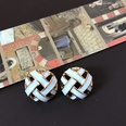 NHOM1469534-Woven-effect-hollow-silver-needle-stud-earrings