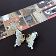 NHOM1469539-Light-colored-small-butterfly-silver-pin-earring