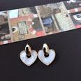NHOM1469541-Heart-shaped-silver-pin-stud-earrings