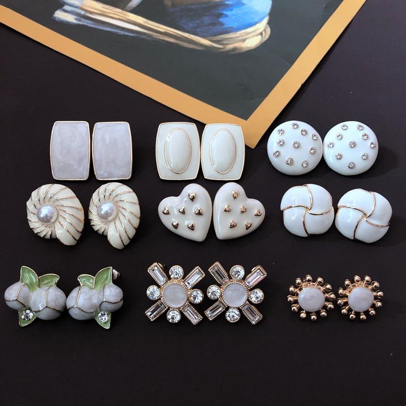 Milky white glaze 925 silver needle earrings NHOM318906