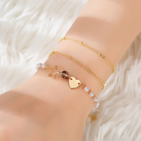 Fashion hollow five-pointed star love imitation pearl bracelet set NHQC319057's discount tags