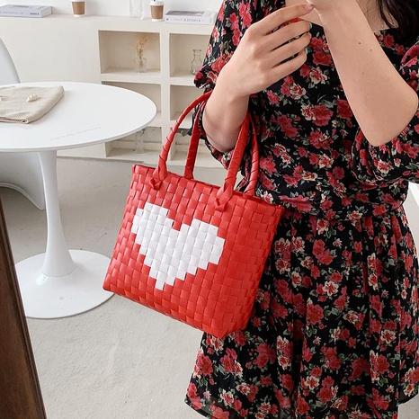 Fashion heart woven portable bag wholesale NHTG325770's discount tags
