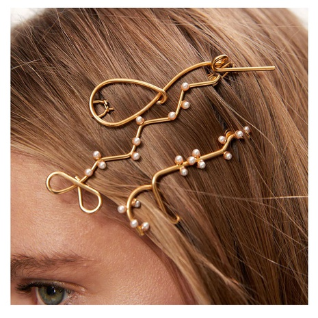 Korean sweet pearl creative irregular hairpin NHCT326452's discount tags