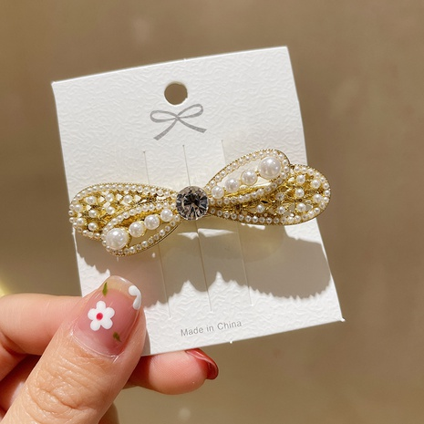 Korea Pearl Bowknot Hairpin  NHMS326744's discount tags