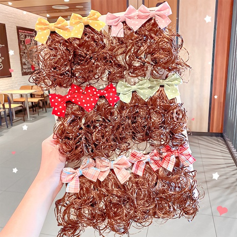 Korean Cute Bow Hairpin Wholesale NHNA326812's discount tags