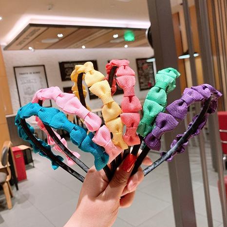 Koreanische bonbonfarbene Stirnband mit Schleifenknoten im Großhandel NHSA326826's discount tags