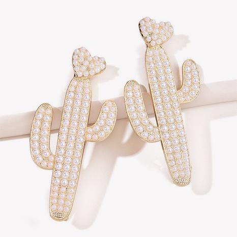 Three-dimensional geometric golden plant pearl hair clip NHGE326955's discount tags