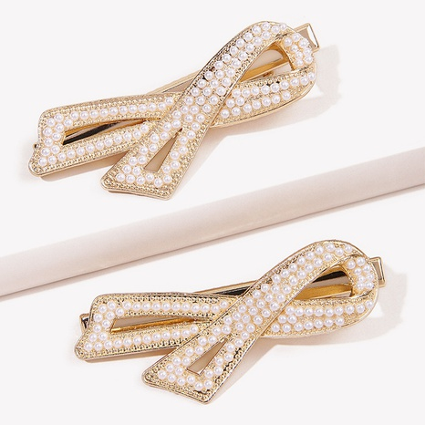 Fashion simple pearl bow hair clip NHGE326956's discount tags