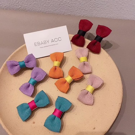 Korea children's solid color bow hairpin NHCQ327001's discount tags