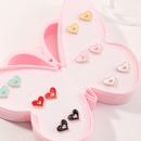 Moda linda aleacin de color caramelo goteando amor aretes fijados NHNU327666
