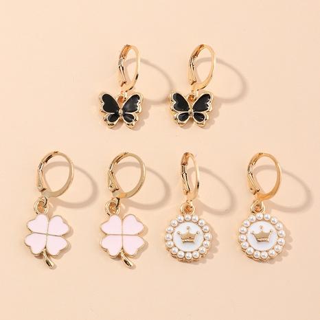 Lindo conjunto de aretes de mariposas con perlas de aceite NHNU327656's discount tags