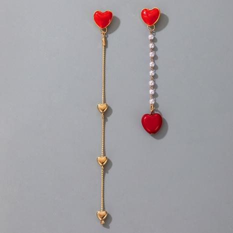 Korea süße Pfirsich Herz Perle Quaste asymmetrische Ohrringe NHGY327641's discount tags
