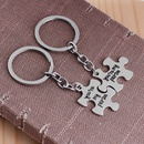 Portecls de puzzle de lettre de mode en gros NHCU329029