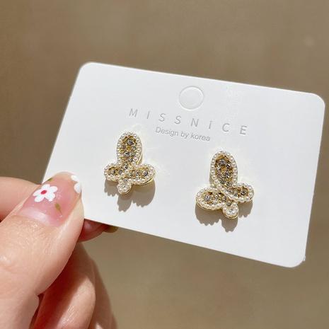 Pendientes de mariposa de perlas de moda al por mayor NHMS329136's discount tags