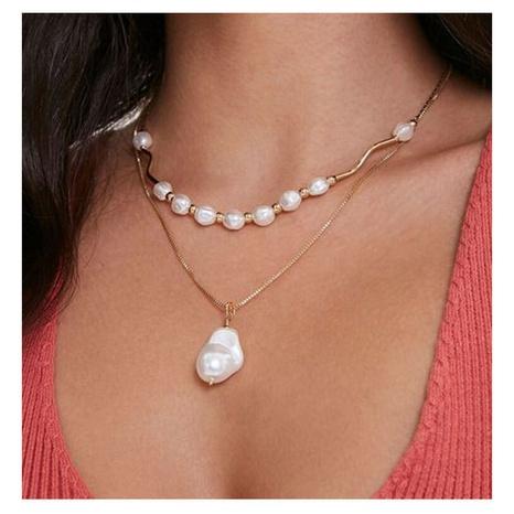 Collier double couche doré avec pendentif perle de forme irrégulière NHCT319926's discount tags