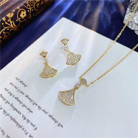 Goldene fächerförmige Ohrringe Halskette gesetzt NHVA320672's discount tags
